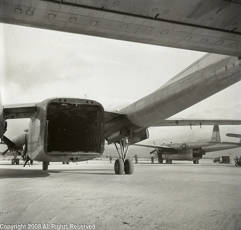 A C-119 flying box car sits unloaded after a mission during the Korean War.