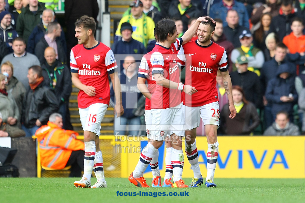Carl Jenkinson of Arsenal scores his sides 2nd goal and celebrates during the Barclays Premier League match at Carrow Road, Norwich<br /> Picture by Paul Chesterton/Focus Images Ltd +44 7904 640267<br /> 11/05/2014