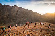 Sinai, Egypt, December 2018.  Sunrise at El Faria while hiking with the Tarabin Tribe through the Sinai Desert Coastal Ranges.  The Sinai Trail is Egypt's 1st long distance hiking trail, running 230km from the Gulf of Aqaba to the top of the Sinai's highest mountain. It connects old trade, travel and pilgrimage routes through one of the Middle East's most iconic desert wildernesses and is managed by a cooperative of three Bedouin tribes. Photo by Frits Meyst / MeystPhoto.com