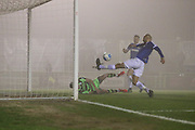 Dovers Richard Orlu clears Forest Green Rovers Kieffer Moore(14) header off the line during the Vanarama National League match between Forest Green Rovers and Dover Athletic at the New Lawn, Forest Green, United Kingdom on 17 December 2016. Photo by Shane Healey.