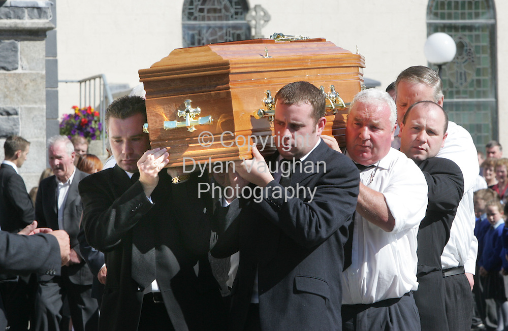 6/9/2005.The coffin of James Healy pictured being taken from the church in Paulstown County Kilkenny carried by his two brothers front Brian and Pearse..Picture Dylan Vaughan.