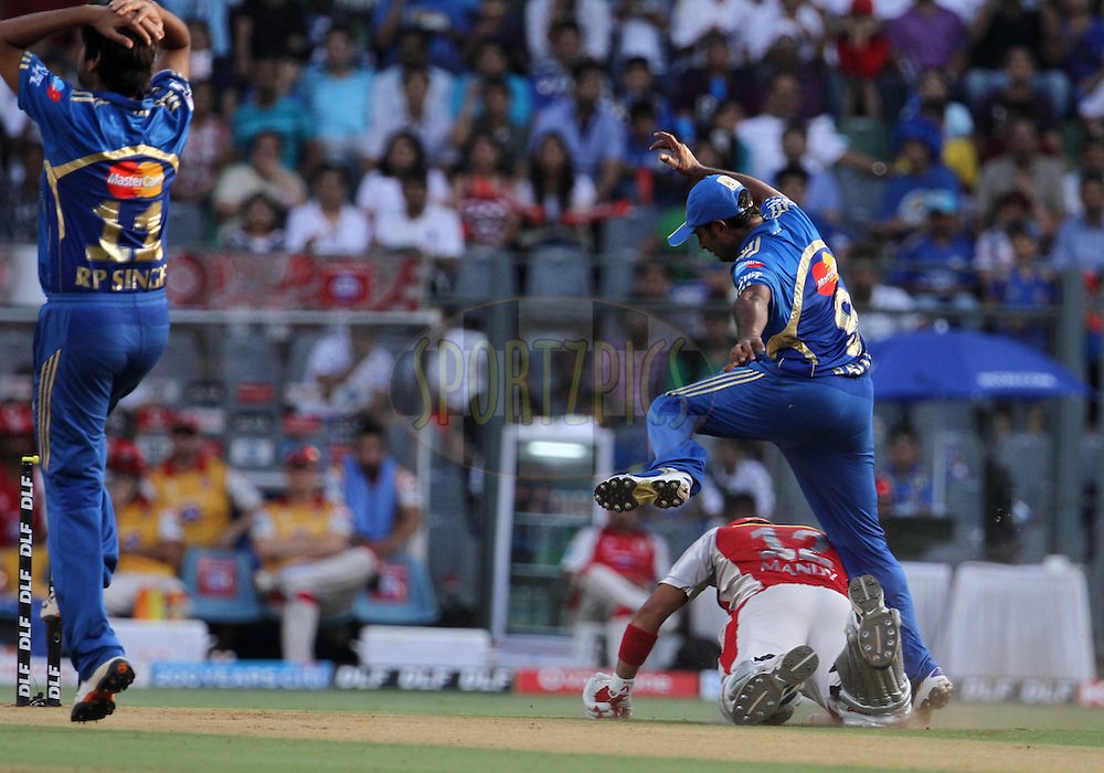 Mumbai Indian player Ambati Rayudu jumps over Kings XI Punjab player Mandeep Singh during match 28 of the Indian Premier League ( IPL) 2012  between The Mumbai Indians and the Kings X1 Punjab held at the Wankhede Stadium in Mumbai on the 22nd April 2012..Photo by: Vipin Pawar/IPL/SPORTZPICS