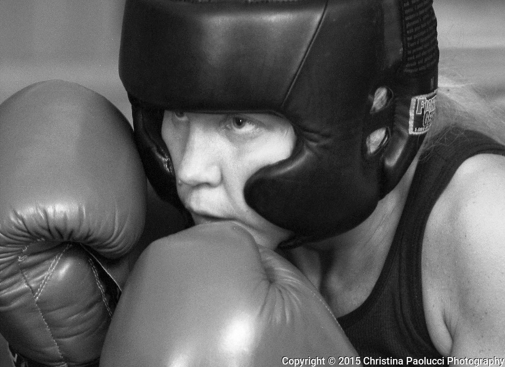 It was by accident that Lorie Mueller,31, caught an interest into the world of boxing, having never played any sport before in her life.After a few amateur matches in the past two years, she began preparing for her professional boxing debut. She trains in the gym every day,works a fulltime job, and raises a family.