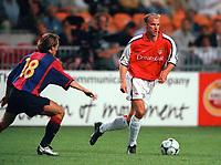 Dennis Bergkamp (Arsenal) and Boudewijn Zenden (Barcelona). Arsenal v FC Barcelona, The Amsterdam Tournament, Amsterdam Arena, Holland, 3/8/2000. Credit Colorsport / Stuart MacFarlane.
