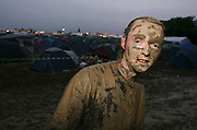 A young festival goer covered in mud, Glastonbury 2005