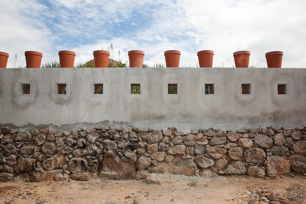 """""""Pots on a Wall"""" - These pots on a wall were photographed Parador San Sebastian, Mexico."""