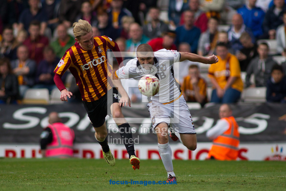 Oliver McBurnie (L) of Bradford City chases down Carl Dickinson (Captain) (R) of Port Vale during the Sky Bet League 1 match at the Coral Windows Stadium, Bradford<br /> Picture by Stephen Gaunt/Focus Images Ltd +447904 833202<br /> 27/09/2014