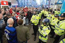 © Licensed to London News Pictures . 13/05/2013 . Manchester , UK . Police confront 100s of Manchester United fans outside the Manchester City store on Market Street after the Manchester United victory parade , this evening (13th May 2013) in Manchester City Centre . Photo credit : Joel Goodman/LNP