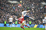 Tottenham Hotspur Forward Harry Kane (10) and Arsenal Defender Shkodran Mustafi (20) challenge the header during the Premier League match between Tottenham Hotspur and Arsenal at Wembley Stadium, London, England on 10 February 2018. Picture by Stephen Wright.