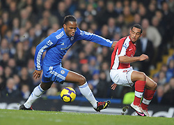 LONDON, ENGLAND - Sunday, February 7, 2010: Chelsea's Didier Drogba and Arsenal's Theo Walcott during the Premiership match at Stamford Bridge. (Photo by Chris Brunskill/Propaganda)