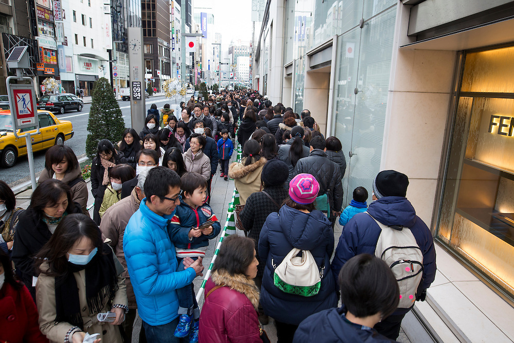 "TOKYO, JAPAN - JANUARY 2 : People wait in a queue line for the gate of Matsuya Ginza Department store to purchase the New Year's first winter sale ""Fukubukuro"" or ""lucky bags"" in Ginza, Tokyo on January 2, 2017. A Japanese New Year custom in which merchants make grab bags filled with unknown random contents and sell them for a substantial discounted price. (Photo by Richard Atrero de Guzman/NURPhoto)"