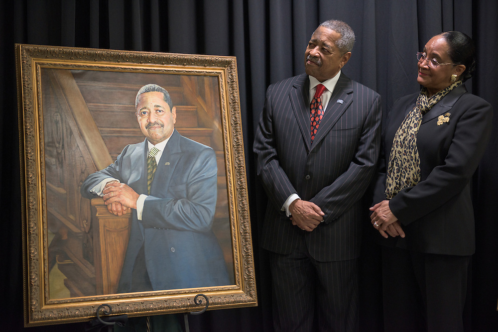 Ohio University President Roderick McDavis and his wife, Deborah McDavis, see their portraits at an unveiling ceremony held at the newly renovated McCracken Hall on February 9, 2017.