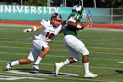 01 October 2016:  Nick Blazek gets an arm around Maurice Shoemaker-Gilmore during an NCAA division 3 football game between the Wheaton Thunder and the Illinois Wesleyan Titans in Tucci Stadium on Wilder Field, Bloomington IL (Photo by Alan Look)