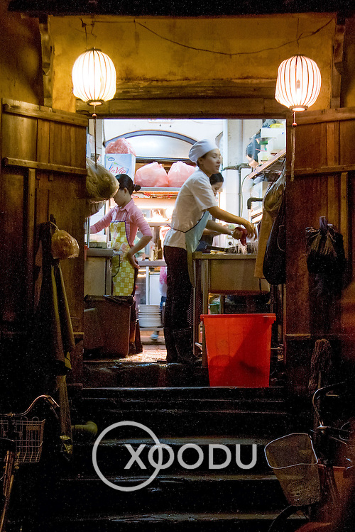 Chefs in doorway of simple restaurant kitchen (Hoi An, Vietnam - Nov. 2008) (Image ID: 081109-1748172a)