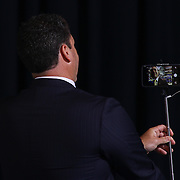 Alexis I. duPont High School Principal Kevin M. Palladinetti using a selfie stick to take a photo during duPont High School commencement exercise Saturday, June 06, 2015, at The Bob Carpenter Sports Convocation Center in Newark, Delaware.