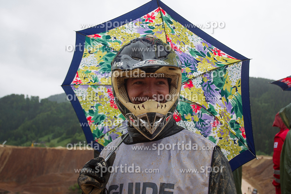 30.05.2013, Erzberg, Eisenerz, AUT, Erzbergrodeo, Kaercher Rocket Ride, im Bild ein Guide mit Regenschirm // during the Erzbergrodeo, Kaercher Rocket Ride,  at the Erzberg, Eisenerz, Austria on 2013/05/30, EXPA Pictures © 2013, PhotoCredit: EXPA/ Erwin Scheriau
