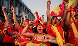 Fans react after Spain scored during the World Cup semifinal soccer match between Spain and Germany on a large screen outside the Santiago Bernabeu stadium in Madrid, on Wednesday, July 7, 2010. Millions of people worldwide are following the World Cup soccer tournament which is been held in South Africa, and broadcast to a diverse community of football fans. Spain won 1-0.
