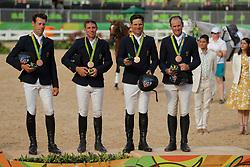 Griffiths Sam (AUS), Burton Christopher (AUS), Tinney Stuart (AUS), Rose Shane (AUS)<br /> Burton, Christopher (AUS);<br /> Tinney, Stuart (AUS);<br /> Rose, Shane (AUS), <br /> Rio de Janeiro - Olympische Spiele 2016<br /> Siegerehrung Vielseitigkeit Mannschaftsentscheidung<br /> © www.sportfotos-lafrentz.de/Stefan Lafrentz