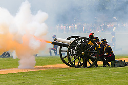 Hyde Park, London, June 10th 2016. As  part of the double celebration of HM The Queen and her Husband HRH Prince Philip, the King's Troop Royal Horse Artillery fire a 41 gun salute in honour of Prince Philip's 95th birthday in London's Hyde Park. PICTURED: The very moment a gun fires discharging its concussive burst of flame and smoke.
