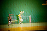 Hernandez (93, red helmet) and Jairo (31, yellow helmet)practice at Dania Jai alai, in Dania, FL.  Feb 23, 2007.  (Photo/Lance Cheung) ..PHOTO COPYRIGHT 2007 LANCE CHEUNG.This photograph is NOT within the public domain..This photograph is not to be downloaded, stored, manipulated, printed or distributed with out the written permission from the photographer. .This photograph is protected under domestic and international laws.