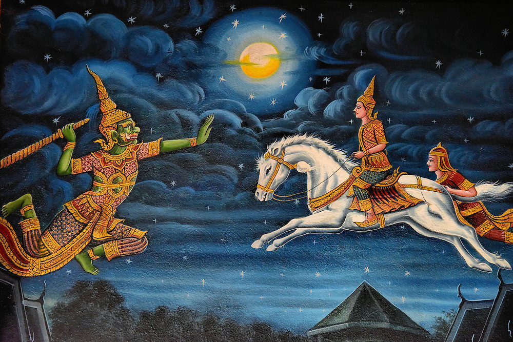Ramakien Epic Mural at Wat Chiang Man in Chiang Mai, Thailand <br /> The walls inside the newest viharn at Wat Chiang Man are decorated with beautiful paintings like this one that is a scene from Thailand&rsquo;s national epic called Ramakien.  Adopted from a Hindu story, this mural shows Sida&rsquo;s son Mongkut (or Kusa) and his friend Lop (Lava) riding a white horse that was released by Rama.  On the left is Hanuman, the God-king of apes and a monkey general.