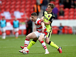 Tommy Rowe of Doncaster Rovers battles with David Wheeler of Exeter City - Mandatory by-line: Robbie Stephenson/JMP - 29/04/2017 - FOOTBALL - The Keepmoat Stadium - Doncaster, England - Doncaster Rovers v Exeter City - Sky Bet League Two