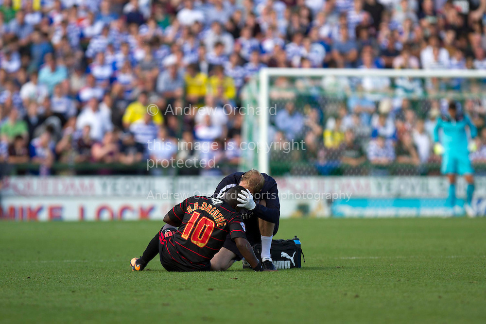Royston Drenthe of Reading receives medical treatment during the Skybet championship match, Yeovil Town v Reading at Huish Park in Yeovil on Saturday 31st August 2013. <br /> Picture by Sophie Elbourn, Andrew Orchard sports photography,