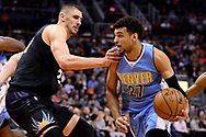 Jan 28, 2017; Phoenix, AZ, USA; Denver Nuggets guard Jamal Murray (27) handles the ball against Phoenix Suns center Alex Len (21) in the first half of the NBA game at Talking Stick Resort Arena. Mandatory Credit: Jennifer Stewart-USA TODAY Sports
