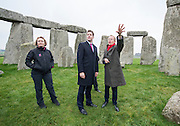 © Licensed to London News Pictures. 01/12/2014. Wiltshire, UK Simon Thurley (red scarf) Director of English Heritage tours the site with Nick Clegg accompanied by Dame Helen Ghosh, Director-General of the National Trust. British Prime Minister Nick Clegg visits The World Heritage Site of Stonehenge in Wiltshire today 1st December 2014. A tunnel passing Stonehenge is among dozens of new road schemes announced by the government, as part of £15bn of improvements to England's roads.. Photo credit : Stephen Simpson/LNP