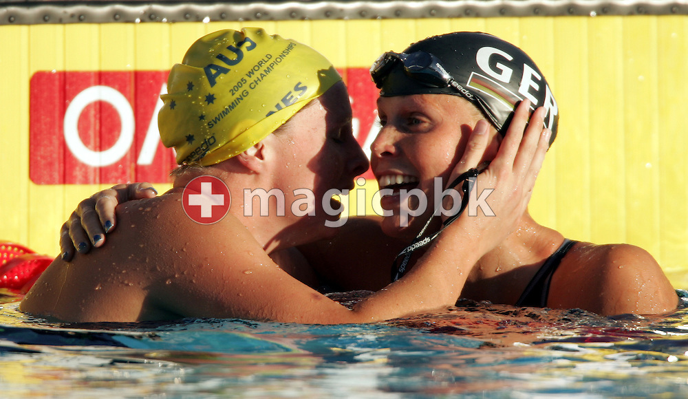 Autralia's Leisel Jones (L) and Germany's Anne Polescka (R) embrace after Jones' gold medal in world record time of 2:21.72 in the women's 200m Breaststroke at the FINA World Championships in Montreal, Canada Friday 29 July, 2005. Poleska won the silver medal in the race. (Photo by Patrick B. Kraemer / MAGICPBK)