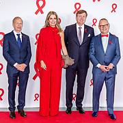 NLD/Amsterdam/20180516 - Koningspaar bij Red Ribbon Concert, Koning Willem Alexander en Koningin Maxima en Bertus Tempert