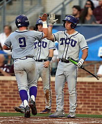 TCU's Evan Skoug (9) high fives teammate Josh Watson (7) as he crosses home plate for a run scored against Texas A&M during the 1st inning of a NCAA college baseball super regional tournament game, Friday, June 10, 2016, in College Station, Texas. (AP Photo/Sam Craft)