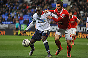 Bolton Wanderers striker, Emile Heskey (19) is challenged by Charlton Athletic defender Harry Lennon (26) during the Sky Bet Championship match between Bolton Wanderers and Charlton Athletic at the Macron Stadium, Bolton, England on 19 April 2016. Photo by John Marfleet.