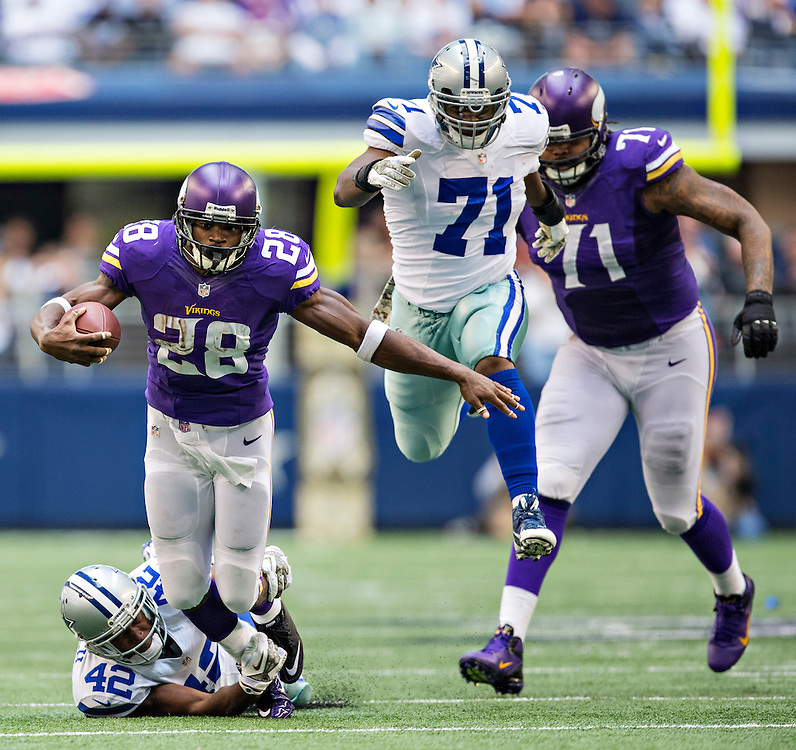 ARLINGTON, TX - NOVEMBER 3:  Adrian Peterson #28 of the Minnesota Vikings is tackled by Barry Church #42 of the Dallas Cowboys at  AT&T Stadium on November 3, 2013 in Arlington, Texas.  The Cowboys defeated the Vikings 27-23.  (Photo by Wesley Hitt/Getty Images) *** Local Caption *** Adrian Peterson; Barry Church