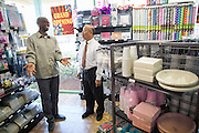 Party Fever owner Mubedi Kaninda give Milpitas Mayor Jose Esteves a personal tour of the new Party Fever store near Dempsey Road during the Milpitas Chamber of Commerce Ribbon Cutting Ceremony at Party Fever in Milpitas, California, on July 31, 2014. (Stan Olszewski/SOSKIphoto)