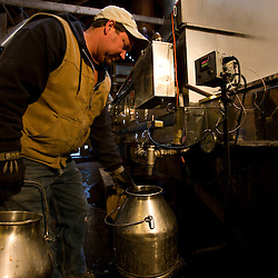 jeff Luce tending the sap bucket in his sugar house  at Sugarbush Farm in Woodstock, Vermont.