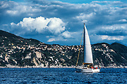 Sailing the Ligurian Coast on a clear day , Italy, Europe.