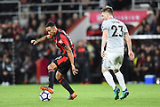 Callum Wilson (13) of AFC Bournemouth gets the better of Luke Shaw (23) of Manchester United during the Premier League match between Bournemouth and Manchester United at the Vitality Stadium, Bournemouth, England on 18 April 2018. Picture by Graham Hunt.