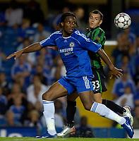 Photo: Daniel Hambury.<br />Chelsea v Glasgow Celtic. Pre Season Friendly. 09/08/2006.<br />Chelsea's Didier Drogba and Celtic's Ross Wallace battle.