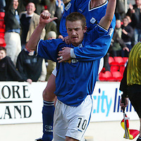 St Johnstone v Inverness Caley Thistle...13.03.04<br />Chris Hay jumps on Keigan Parker after he scores the winnin goal<br />Picture by Graeme Hart.<br />Copyright Perthshire Picture Agency<br />Tel: 01738 623350  Mobile: 07990 594431