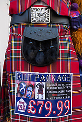 Close up of traditional Scottish tartan kilt and sporran package for sale in tourist shop in Edinburgh Scotland, united Kingdom