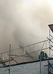 © Licensed to London News Pictures. LONDON, UK  14/06/11. A fire crew tackles a blaze on the top of a building on Aldwich in London today (Tuesday). Please see special instructions for usage rates. Photo credit should read Matt Cetti-Roberts/LNP