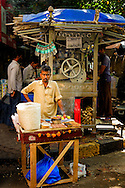A Street food vendor looking straight at the camera in mumbai, india