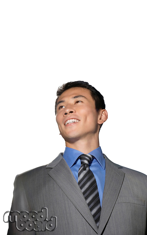 Mid-adult businessman smiling against white background