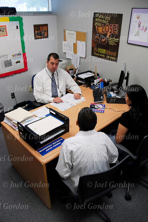 Neighborhood Restoration Justice Coordinator office in the Juvenile Justice Center, intake interview with potential program client, he was referred to program by Judge