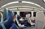 LIRR interior of train car, with several passengers, stopped at Penn Station, NYC, before going to Long Island - a 180 degree fisheye lens view
