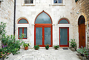 Courtyard with arched windows and Venetian Arch doorway, Sibenik, Croatia