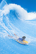 Surfing a standing wave at Wild Wadi water park in Dubai, next to Burj Al Arab and Jumeirah Beach Hotel
