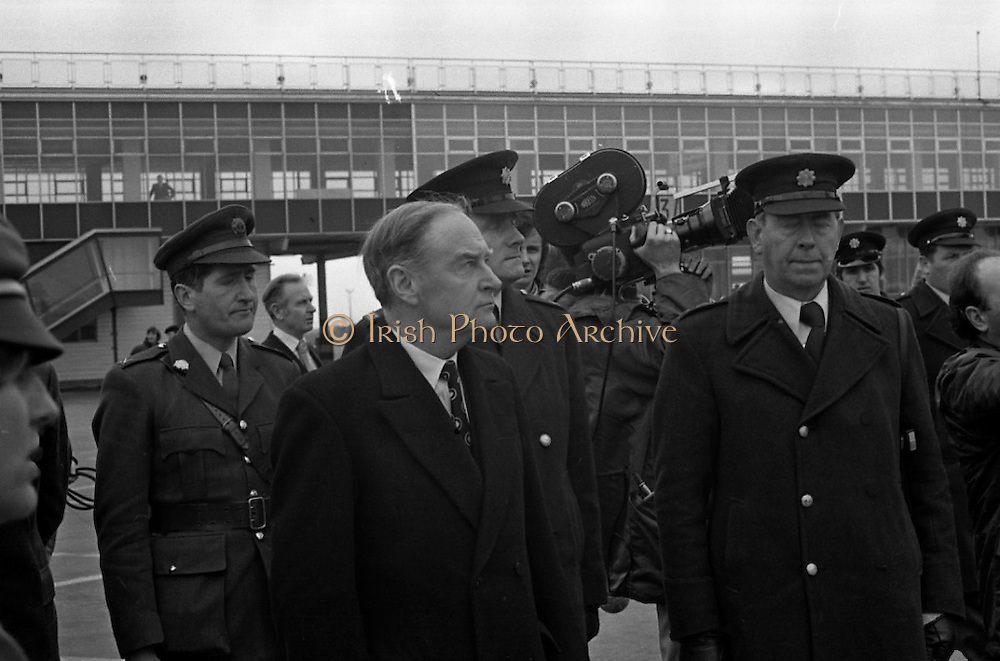 Canadian Prime Minister, Pierre Trudeau arrives in Dublin    (J17).14.03.1975.03.14.1975.3rd April 1975..Pierre Trudeau arrived today for a brief visit to Ireland. He was greeted by the Taoiseach Mr. Liam Cosgrave on his arrival at Dublin Airport. ..Photograph of An Taoiseach Liam Cosgrave, defence force personnel and members of the media as they await the arrival of Canadian Prime Minister Pierre Trudeau.