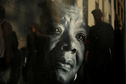 November 13, 2016 - Oakland, California, U.S - People past a bus stop poster of Maya Angelou on Oak Street near Lake Merritt where protestors were gathering to join hands in a peaceful protest against President-elect Donald Trump in Oakland, California. (Credit Image: © Joel Angel Ju'Ä°Rez via ZUMA Wire)